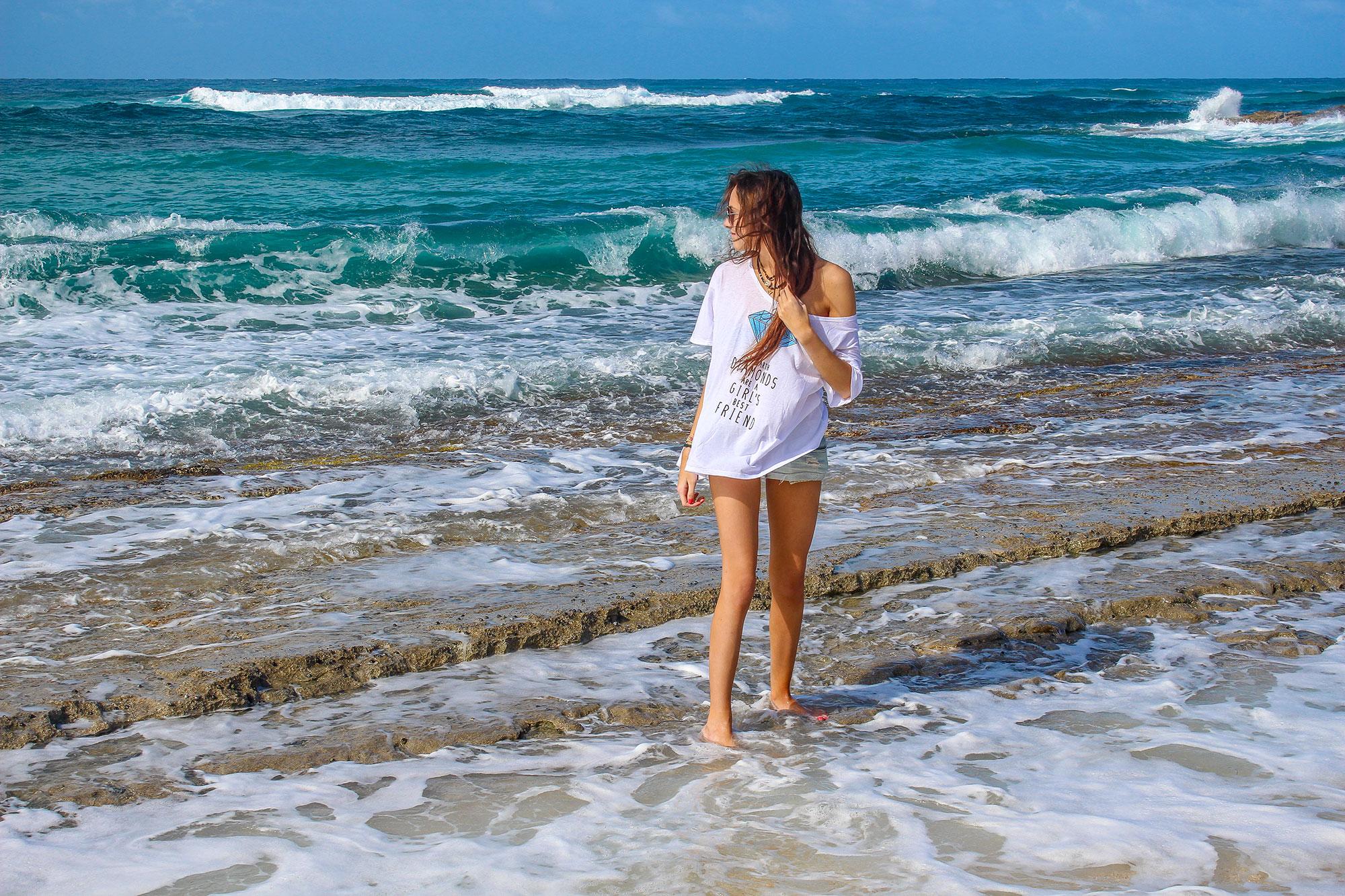 Ella by ocean on beach at Anse de Grand Cul-De-Sac in St Barthélemy